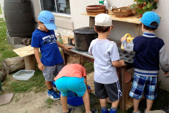 Acorn boys in the mud kitchen