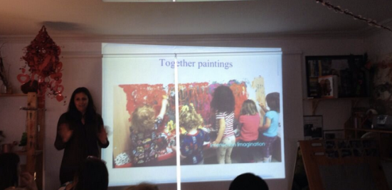 Suzanne discusses together paintings